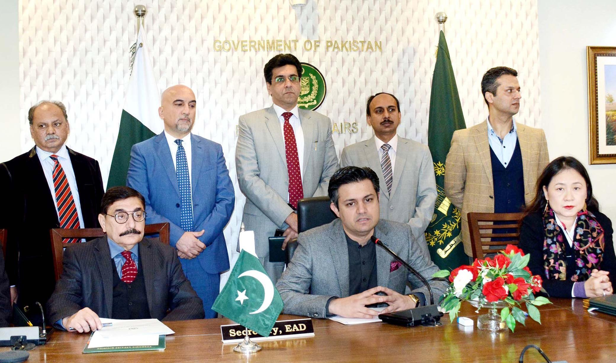 Economic Affairs Division Secretary Dr Syed Pervaiz Abbas and Asian Development Bank Country Director Xiaohong Yang sign loan agreements in Islamabad.