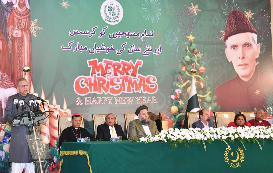 President Dr Arif Alvi cut a cake during a ceremony held at the Aiwan-e-Sadr in Islamabad in connection with Christmas celebrations