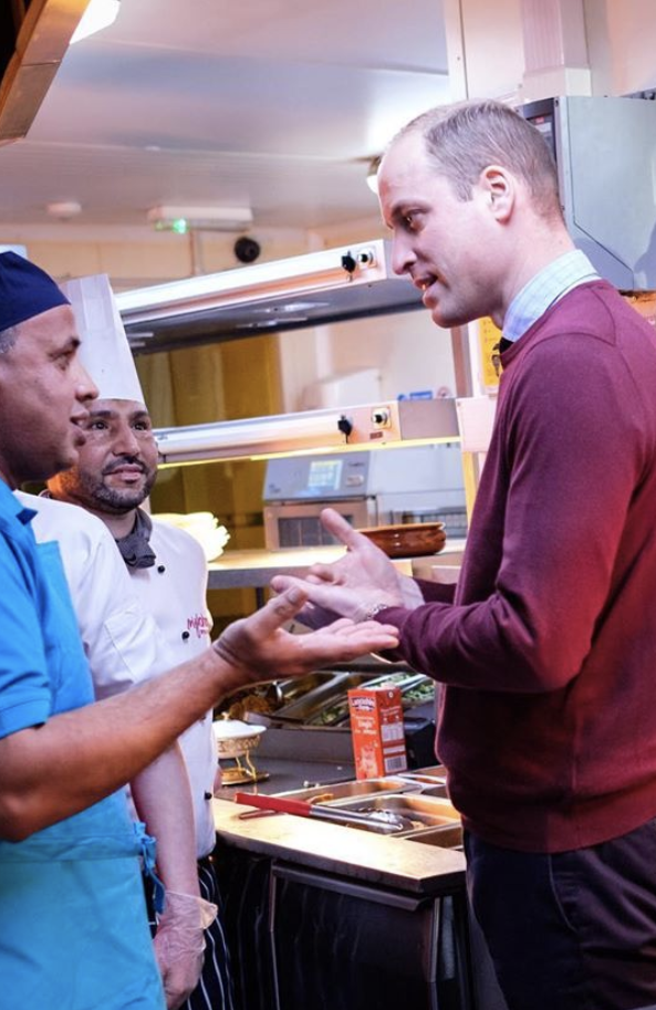 Prince William talking with kitchen staff at MyLahore