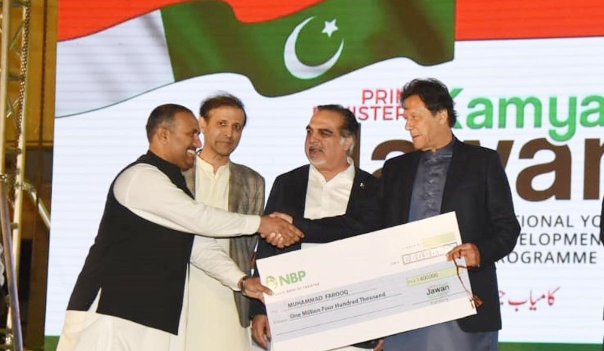 Prime Minister Imran Khan distributing cheques at a ceremony in Karachi